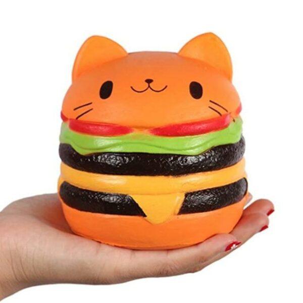 Squishy hamburger chat dans une main