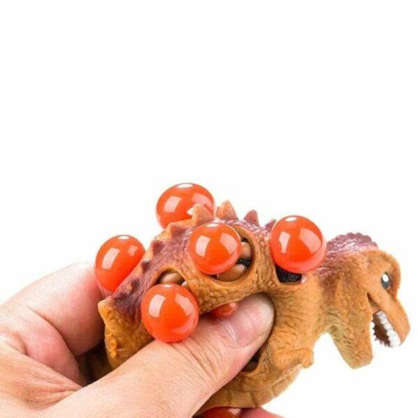 squishy dinosaure gluant écrasé