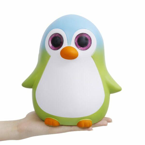 squishy géant pingouin sur la main